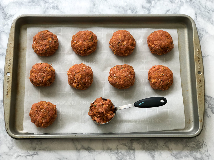 Baked Turkey Burger Sliders on a baking sheet before cooking