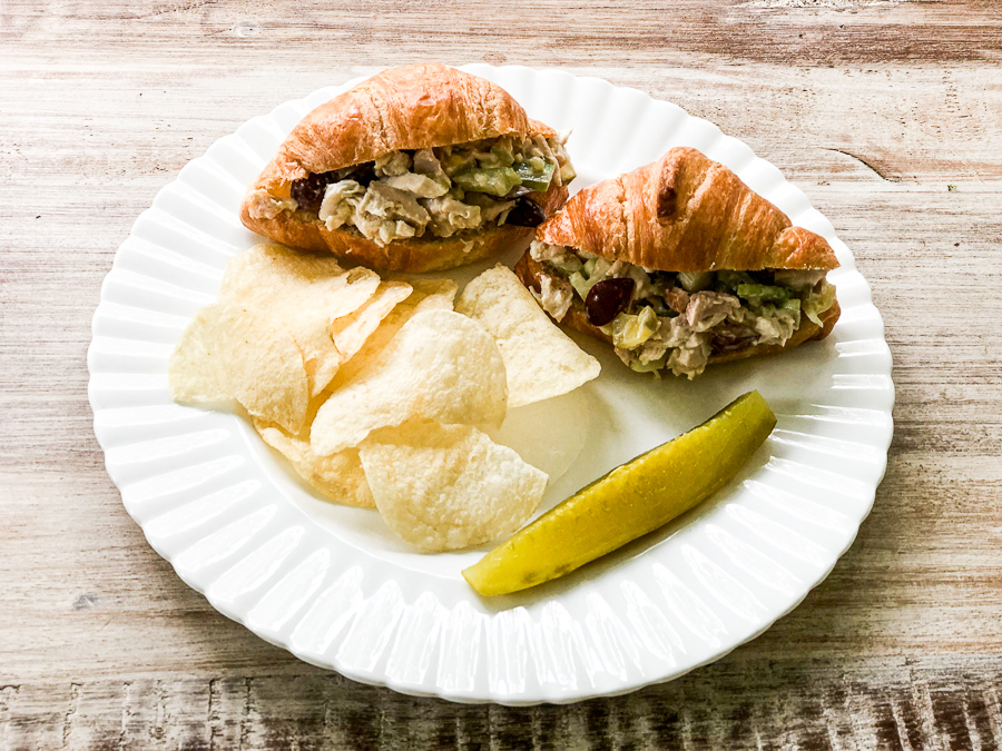 Sam's Club Rotisserie Chicken Salad on a plate in a croissant with potato chips