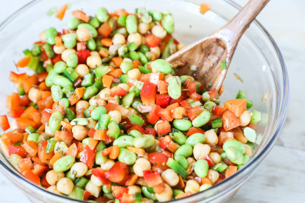 Chickpea and edamame salad mixed in a bowl