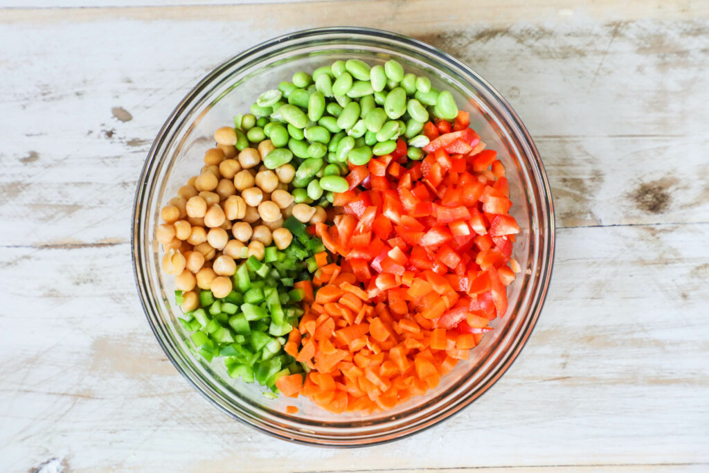 Chickpea and edamame salad ingredients in a bowl