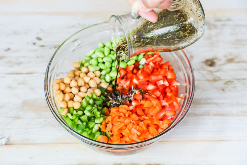 Pouring dressing on salad ingredients