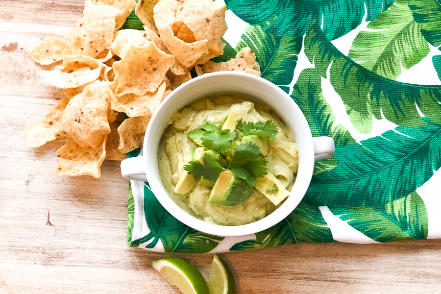 Final product of Avocado Ranch Dip surrounded by tortilla chips.