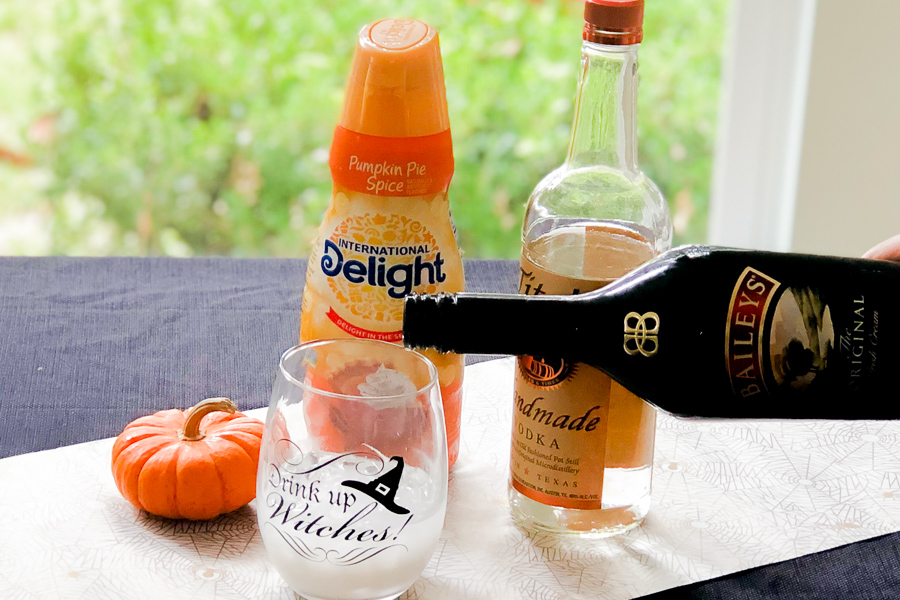 Pouring Bailey's into Halloween glass