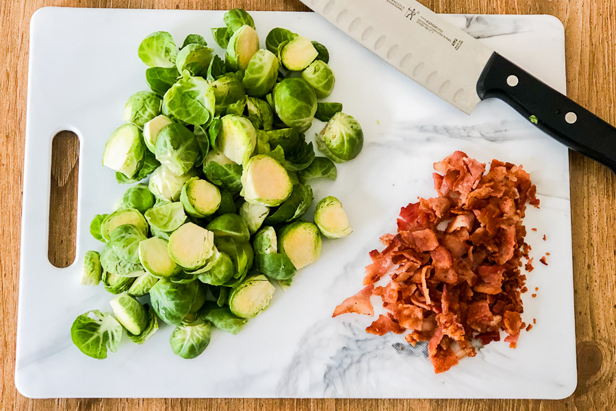 Brussel Sprouts and bacon on a cutting board