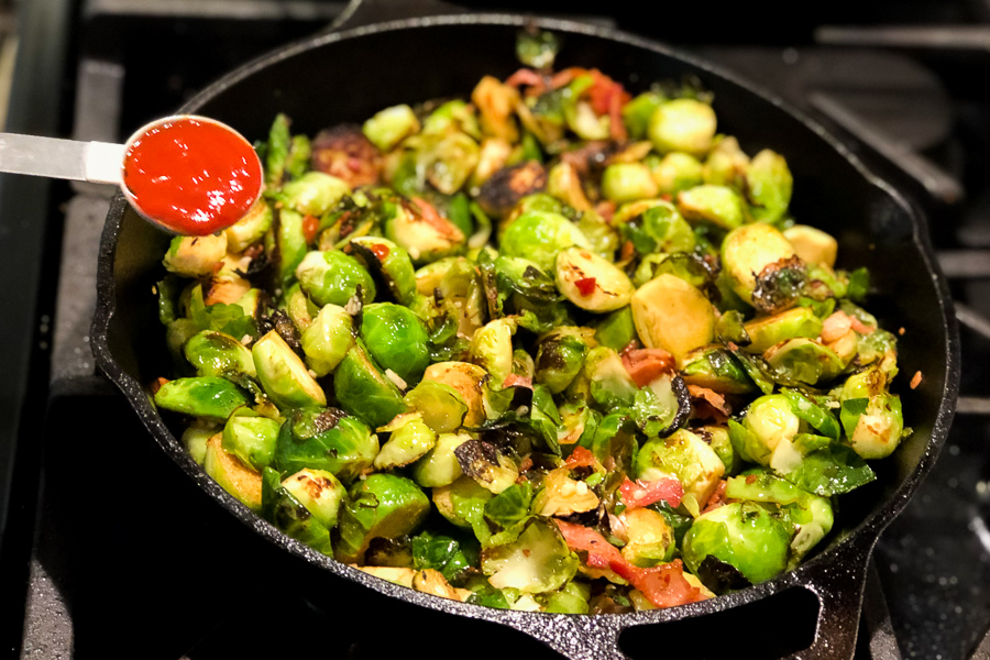 Adding sriracha to Maple Bacon Brussel Sprouts