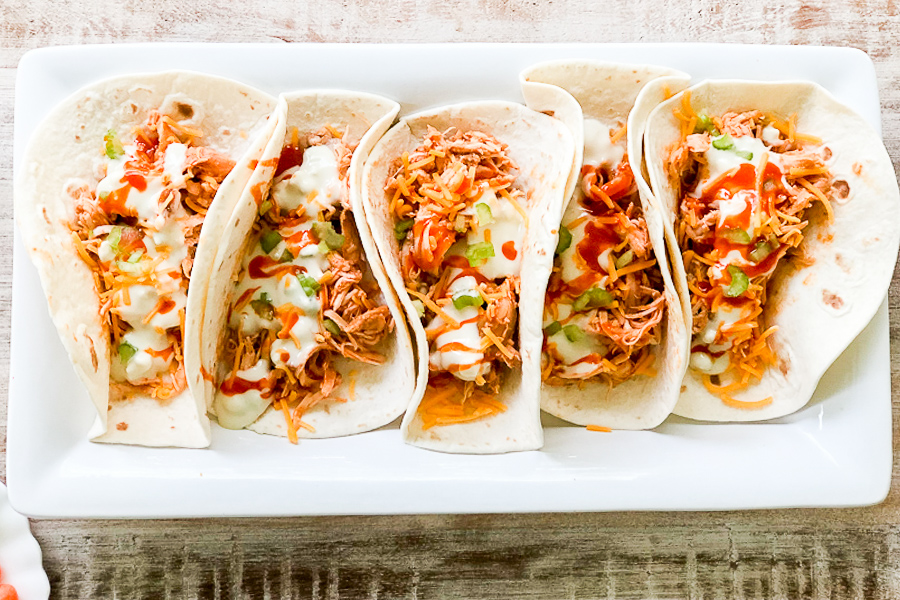 Shredded Buffalo Chicken Tacos on a white plate
