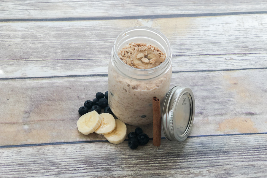 Overnight Oats in a mason jar with banana slices and blueberries