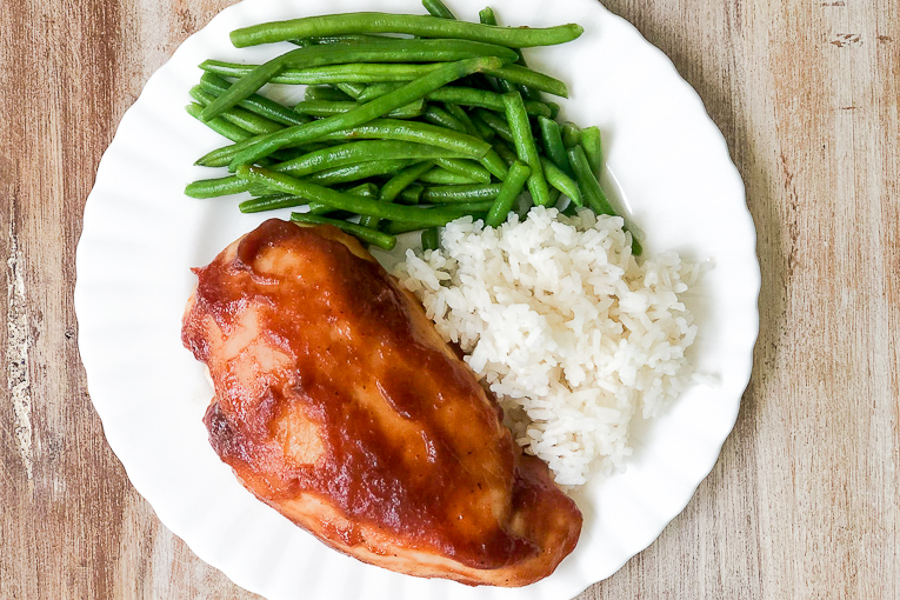Apple Butter Chicken on a plate with rice green beans