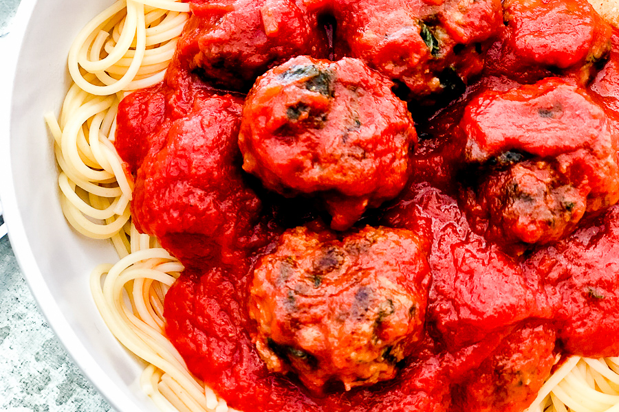 Best Baked Meatballs on a plate with spaghetti