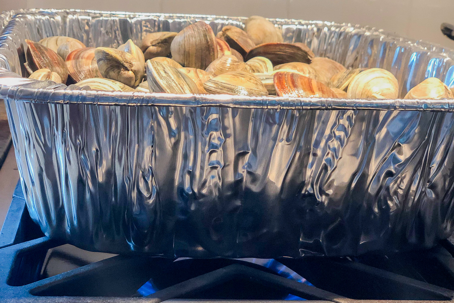 Best Steamed Clams sitting on stovetop over 2 burners.