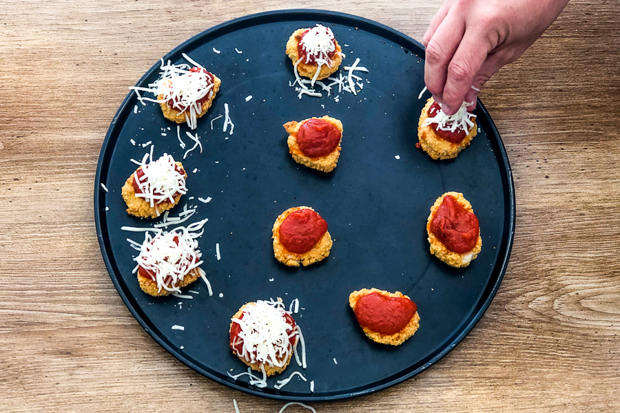 Chicken Parm Bites being made with sauce and mozzarella cheese