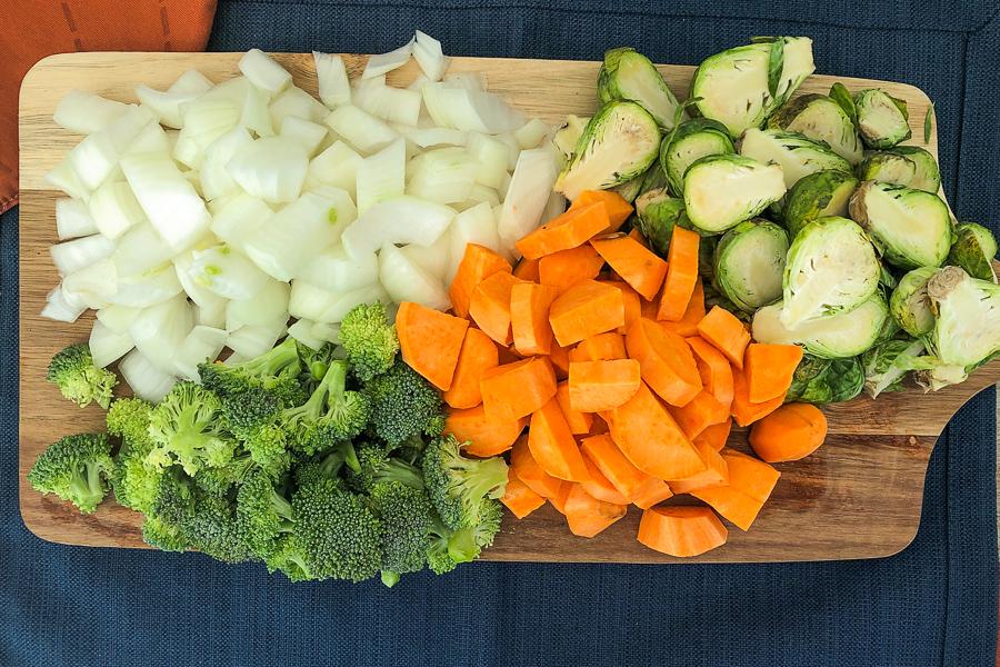 Chopped raw vegetables on a cutting board
