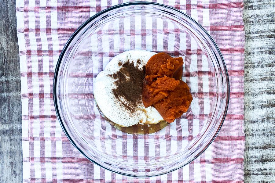 Ingredients for Greek Yogurt Pumpkin Dip in a bowl
