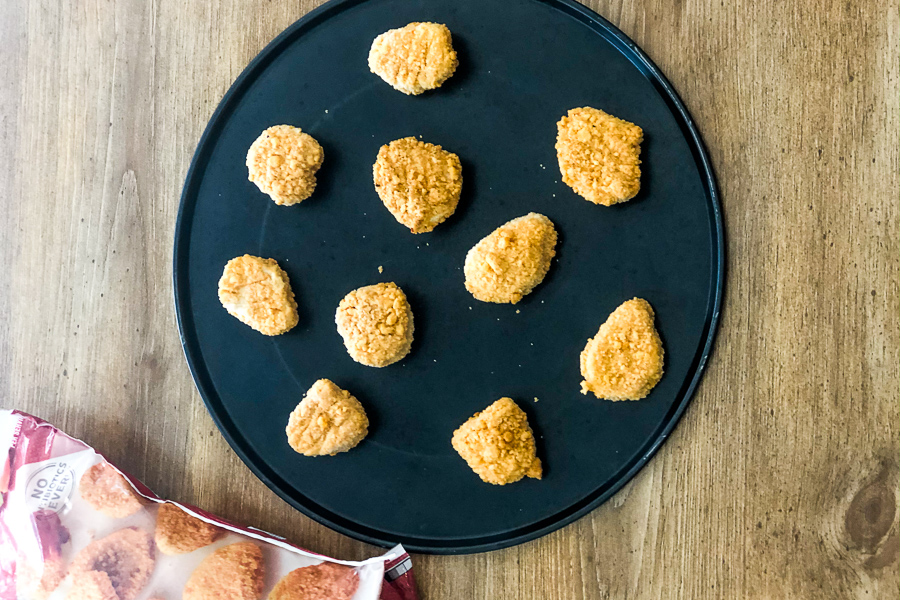 Chicken nuggets on baking sheet
