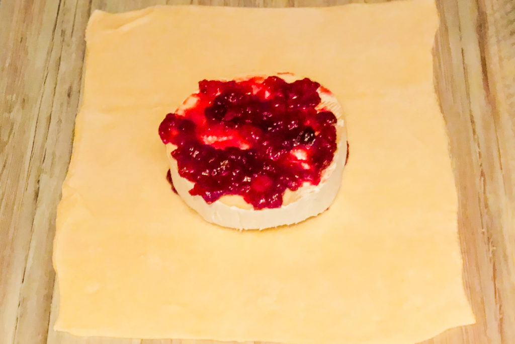 Brie with cranberry sitting on puff pastry