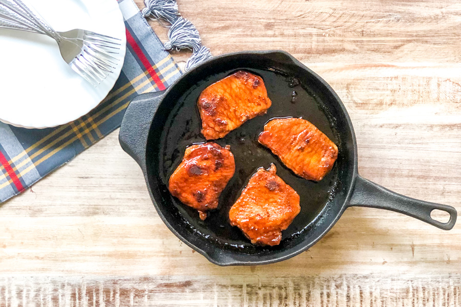 Brown Sugar Glazed Pork in a cast iron pan