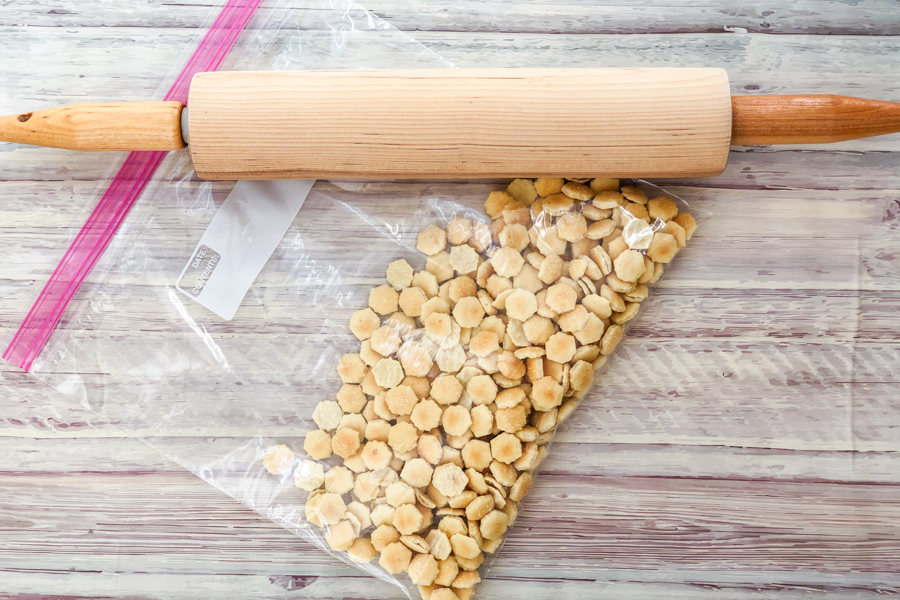 Oyster Crackers in a bag with a rolling pin