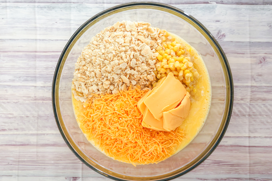 Ingredients in a bowl for Cheesy Corn Casserole