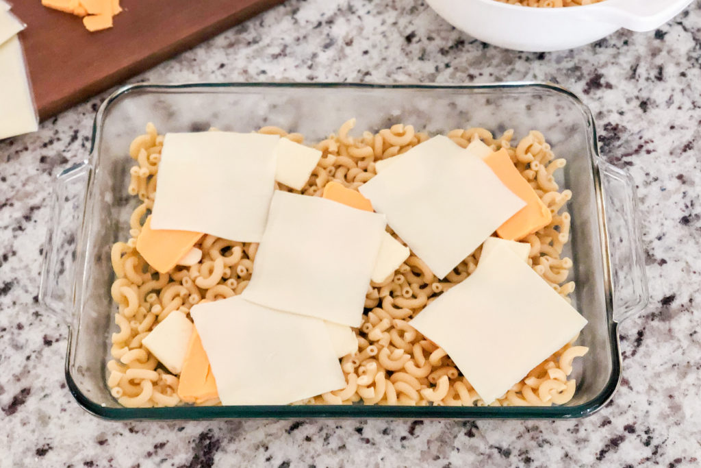 Adding the cheese to Simple Mac and Cheese