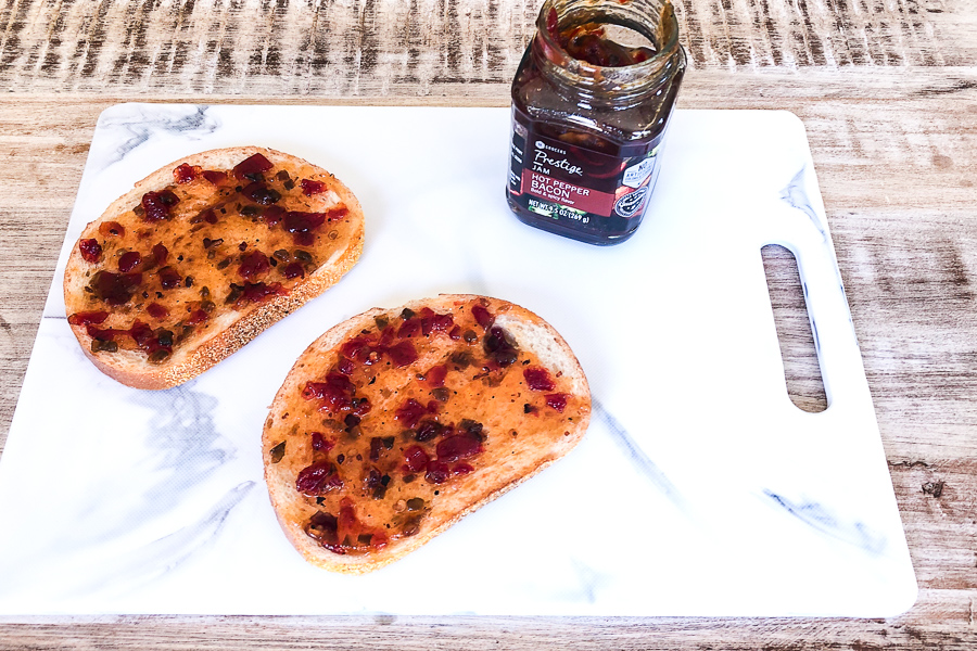 Hot Pepper Bacon Jam spread on 2 slices of bread