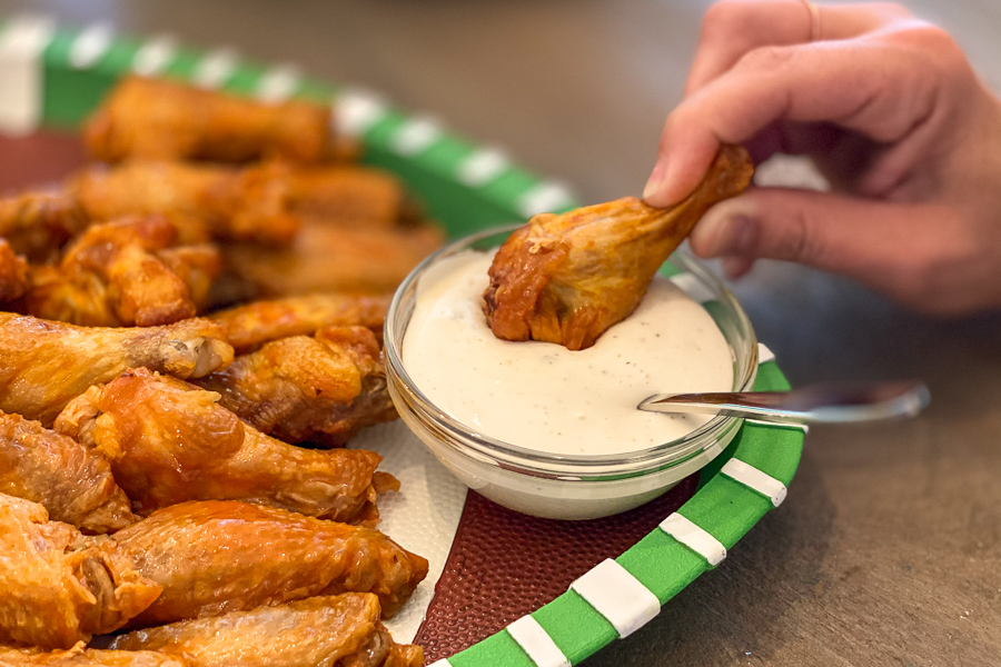 Dipping a wing in ranch dressing