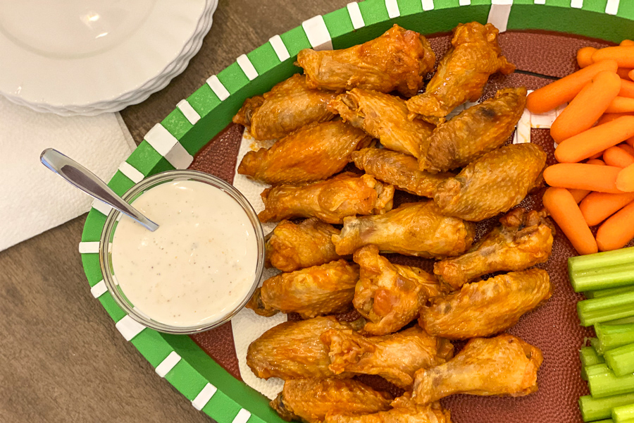 Air Fryer Wings on a football shaped platter
