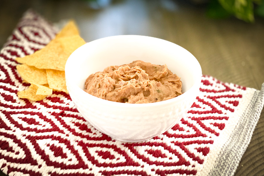 Cheesy Refried Beans in a white bowl