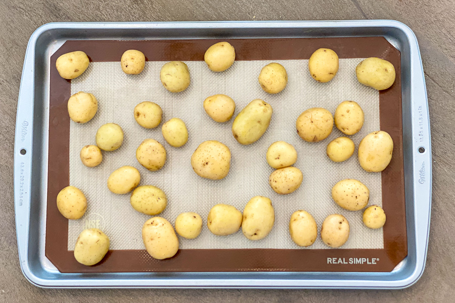 Baby potatoes on a baking sheet.
