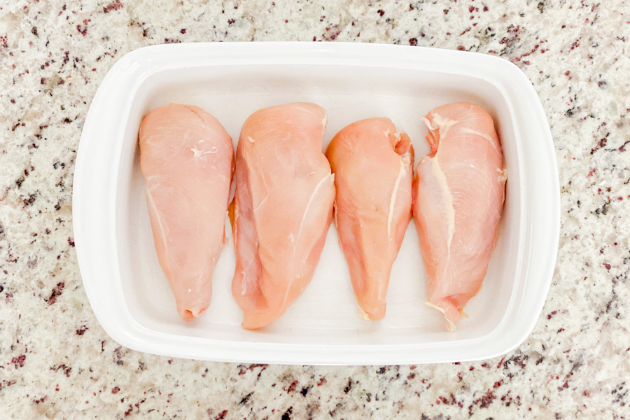 Raw chicken breast in a baking dish