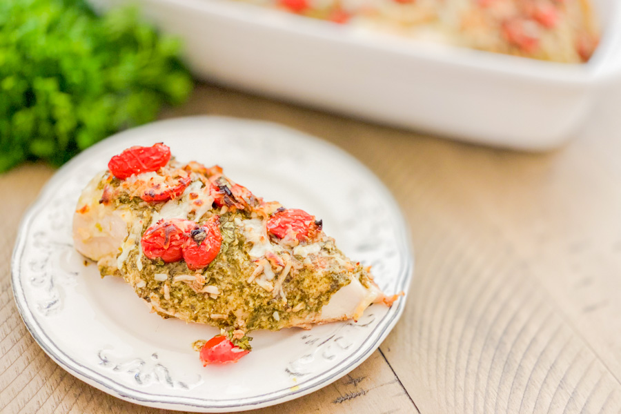 The final outcome of Pesto Bruschetta Chicken Bake on a white plate