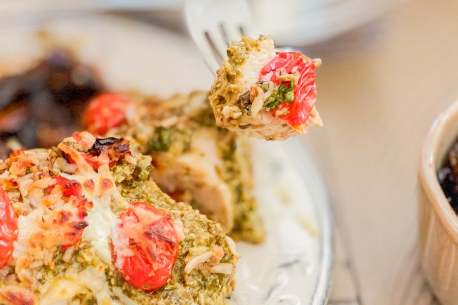 A piece of our Pesto Bruschetta Chicken Bake on a fork