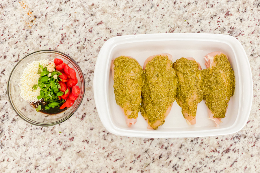 Chicken with pesto covering the top