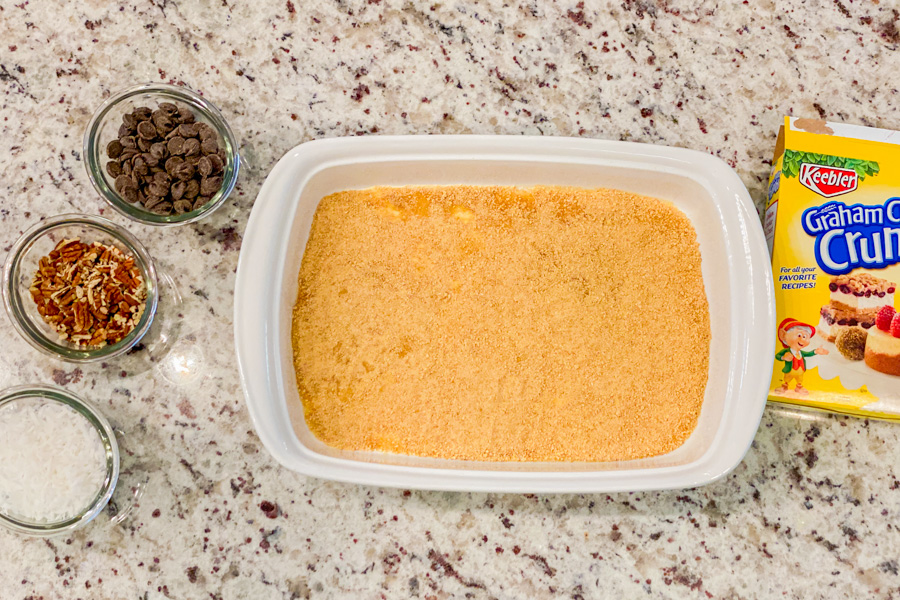 Graham cracker crumbs pressed in the bottom of a casserole dish