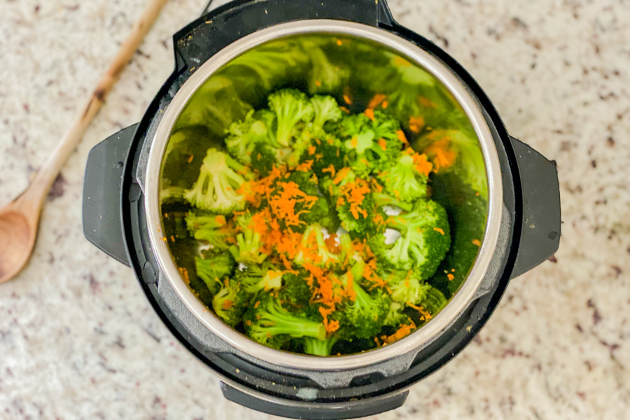Broccoli florets and shredded carrots in a Instant Pot