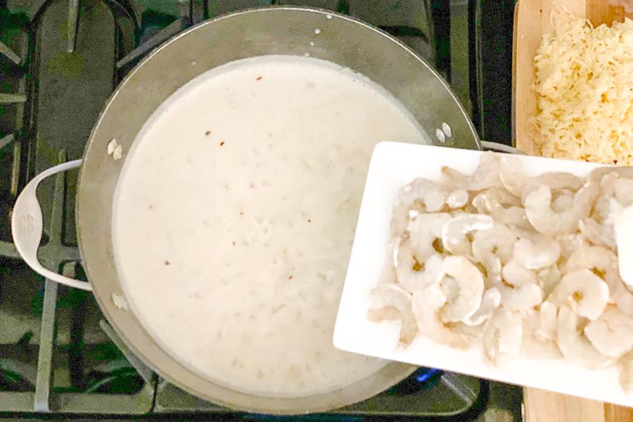 Adding shrimp to Quick Shrimp Chowder.