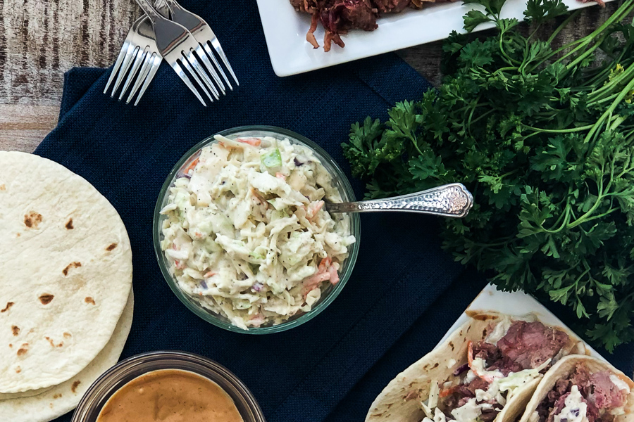 Simple Cole Slaw on a table with BBQ Pulled Pork Tacos
