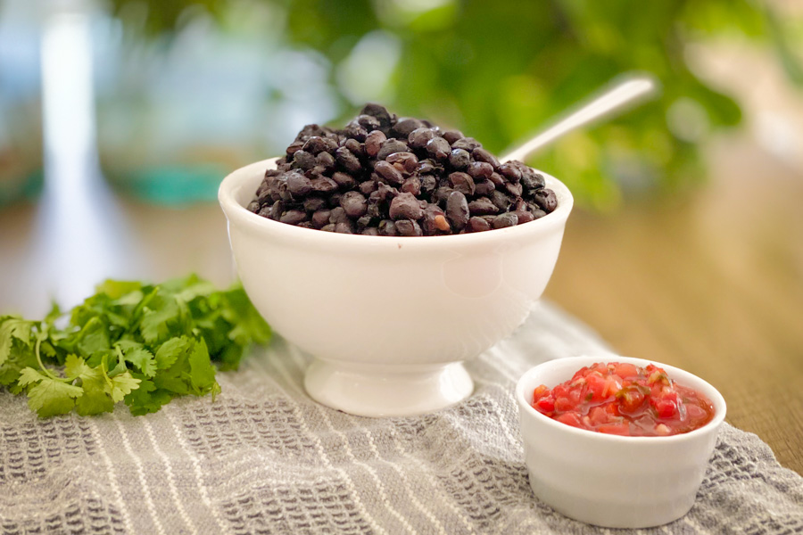 Simple Southwest Black Beans in a white bowl on a table