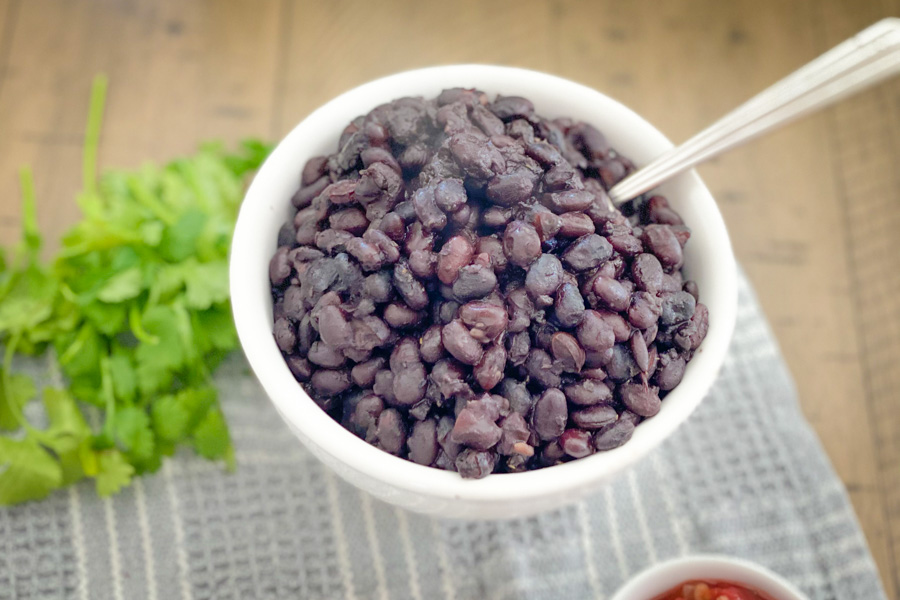 Simple Southwest Black Beans in a bowl with a spoon