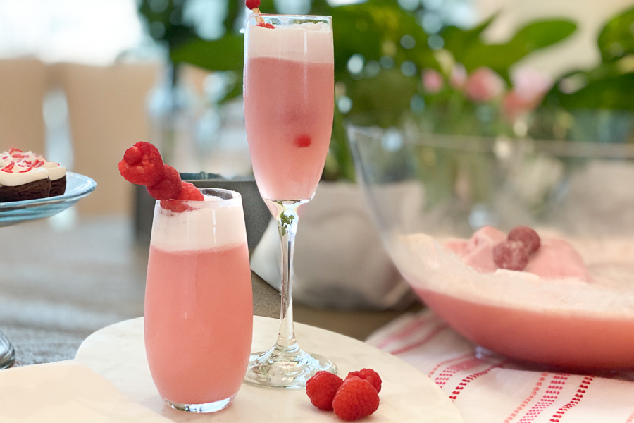 Champagne Sherbet Punch in flutes garnished with raspberries