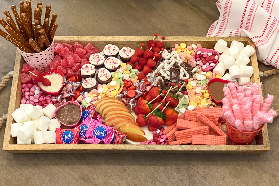 Valentine's Dessert Board filled with candies, fruits and sweets