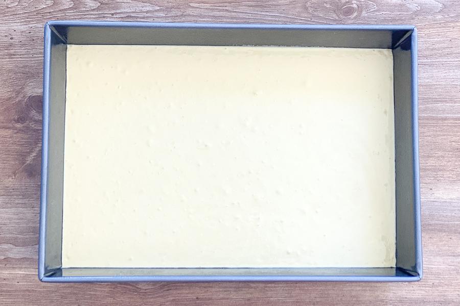 Cake mix batter poured in baking pan