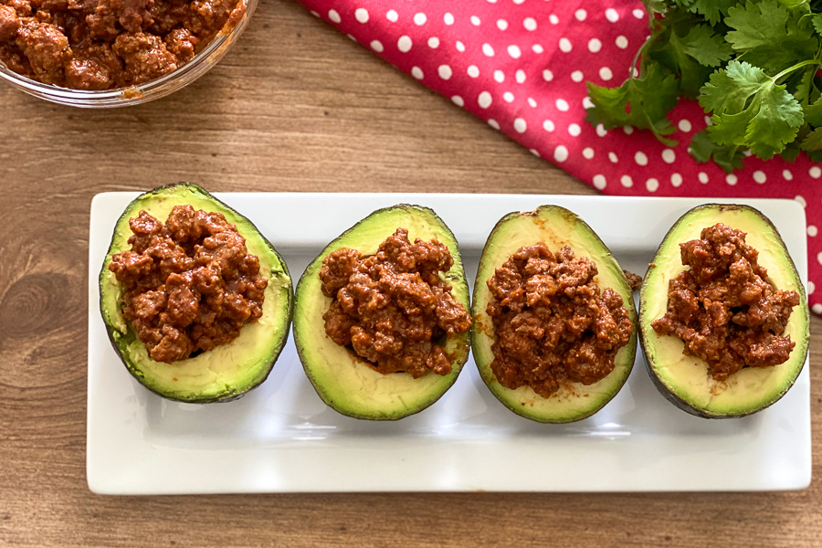 Ground beef in sliced avocados