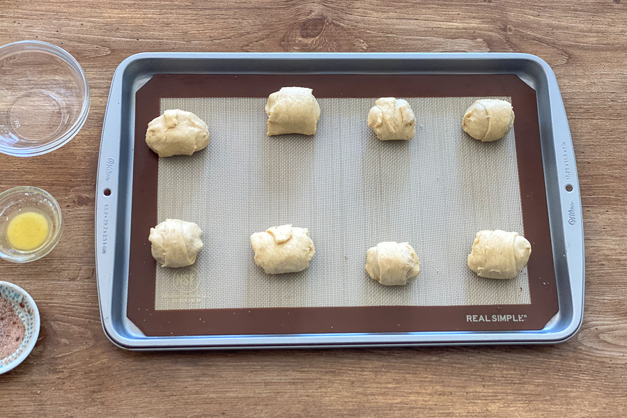 Crescent rolls on a baking sheet ready for the oven