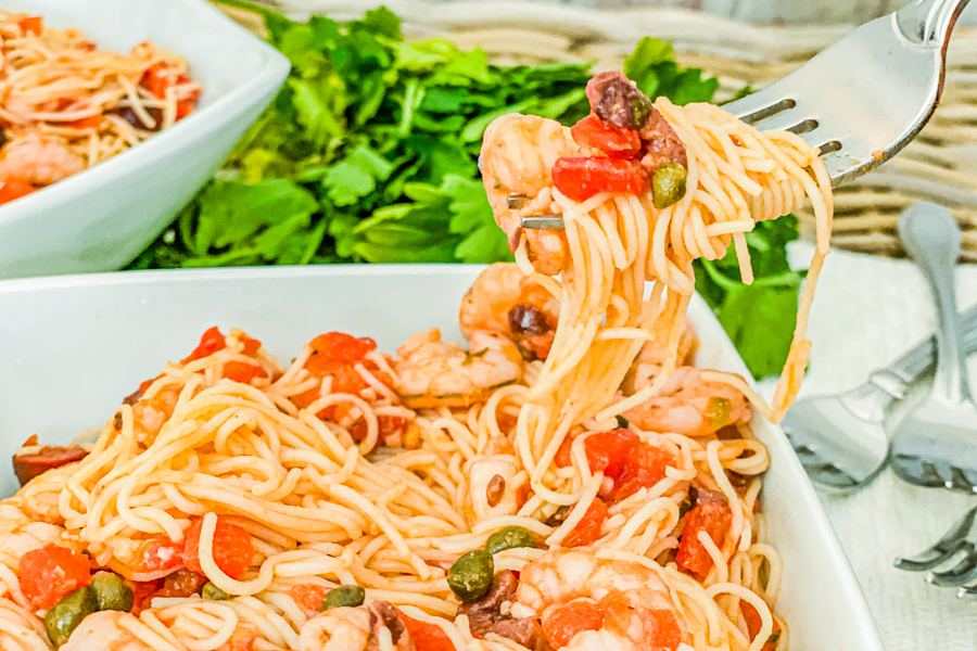 One Pan Shrimp Pasta wound around a fork to showcase the final meal.