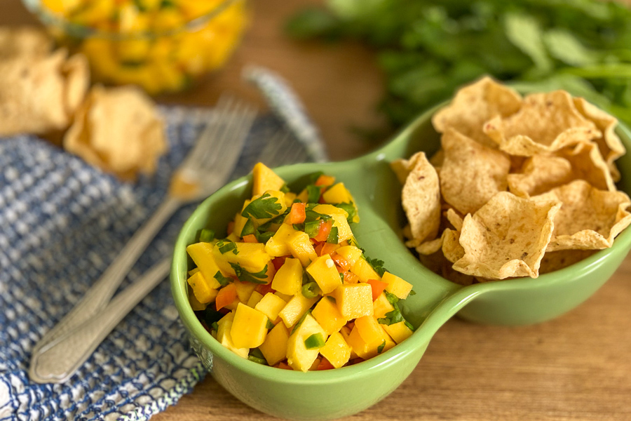 Easy Mango Salsa in a bowl with tortilla chips