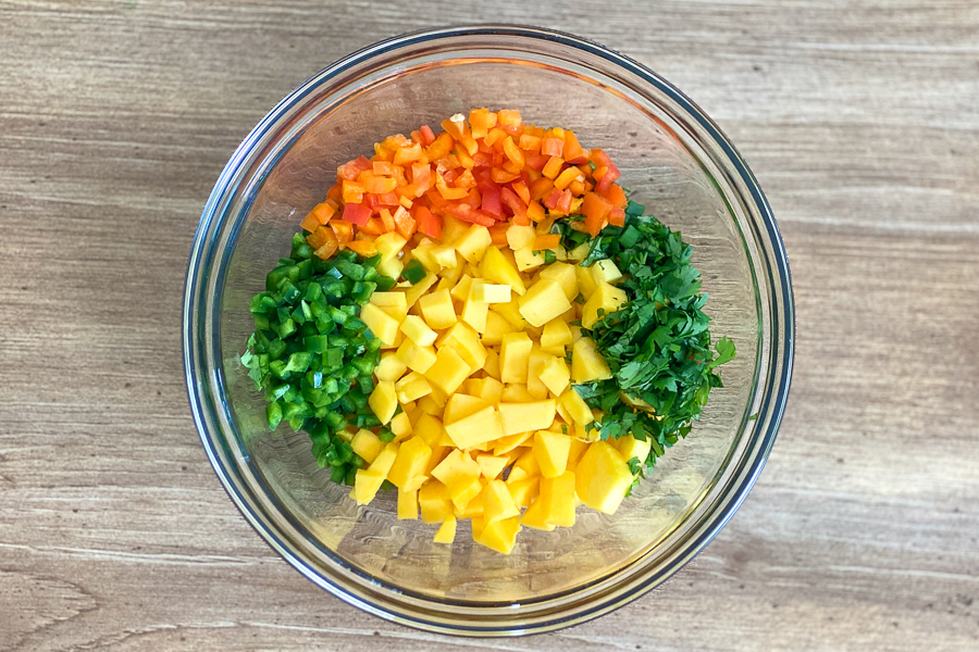 Chopped ingredients in a bowl for Mango Salsa