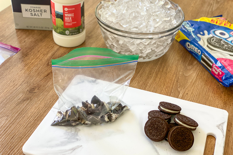 Oreos in a lunch bag with ingredients on table