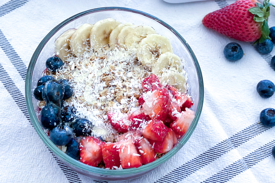 Acai Fruit Bowl with blueberries, strawberries, banana, granola and coconut