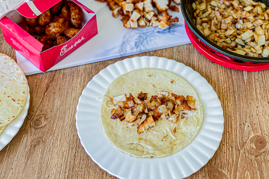 Sauteed onions with diced chicken and mozzarella cheese on tortilla