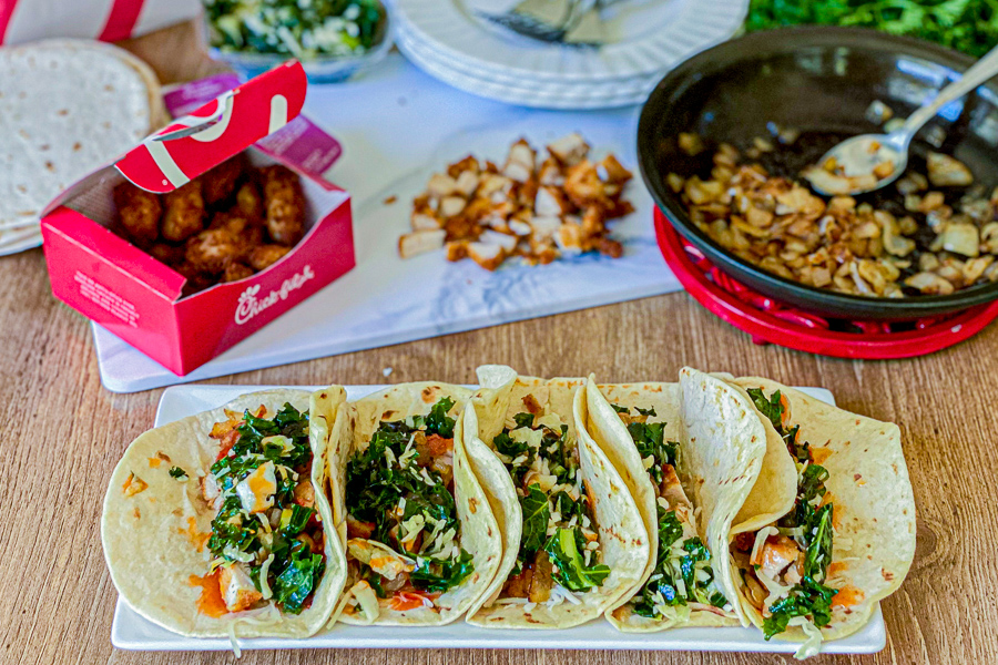 Chick Fil A Tacos with nuggets and sauteed onions in background